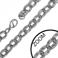 Stainless steel double oval link chain with zig-zag pattern