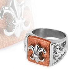 Steel ring with Fleur de Lis symbol on glittering background