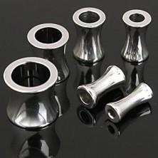Ear piercing - shiny steel tunnel in saddle shape