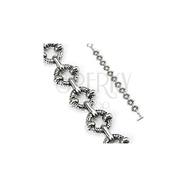 Surgical steel bracelet with textured rings