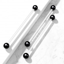 Flexible body piercing - transparent barbell with glossy balls of black colour