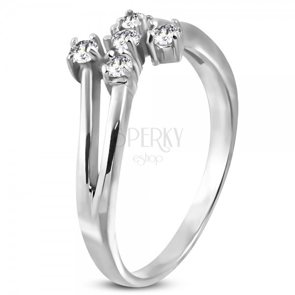 Steel ring in silver colour with five clear zircons