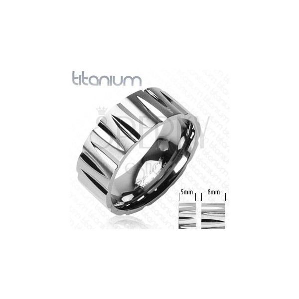 Titanium ring with bullet-shaped cuts