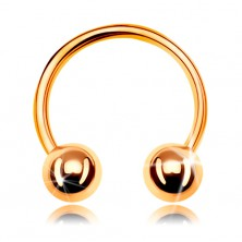 Piercing made of yellow 585 gold, shiny horseshoe ending in two balls