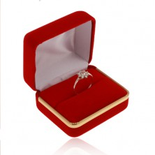 Velvet box for ring, smooth surface in red colour, strip in gold hue
