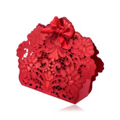 Red gift box with flower patters, cut-outs and ribbon