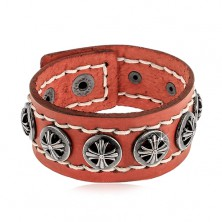Bracelet made of synthetic leather strip in cinnamon colour, round studded rivets with crosses