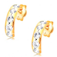 Earrings made of yellow 14K gold - arc with round cutouts and clear zircons