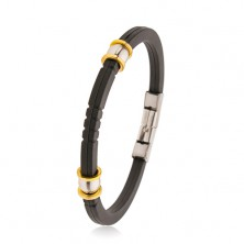 Black rubber bracelet with notches, steel beads in silver and gold colour