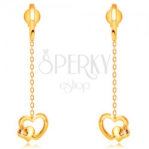 Earrings made of yellow 14K gold - hearts dangling on chain, studs