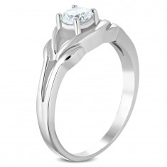 Steel ring of silver color, clear zircon, divided shoulders