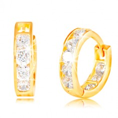 Yellow 14K gold earrings with hinged snap - circles, imbedded sparkling clear zircons