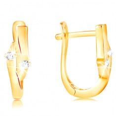 Earrings made of yellow 14K gold - grain with an indent and two clear zircons