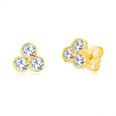 Yellow studs made of 585 gold - trefoil with glittery zircons