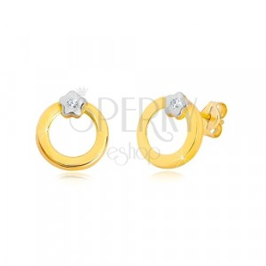 Stud 14K gold earrings - circle with flower in white gold, zircon