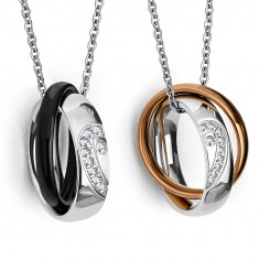 Two steel pendants – shiny rings with, halved heart,thinner colorful rings