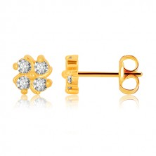 Yellow 375 gold earrings - flower with four zircons and lines slightly twisted