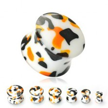White ear plug with black and orange spots