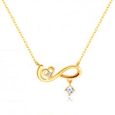 14K Gold pendant – infinity symbol, a symmetrical heart, a clear zircon