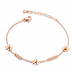 Bracelet from steel, three flowers, shiny balls, chain of angular cells, copper colour