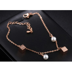 """Steel bracelet of copper colour - mother-of-pearl balls, shiny dices with inscription """"LOVE"""""""