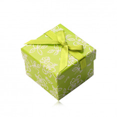 Paper gift box in light green hue, a green ribbon with a bowknot, flowers