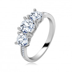 925 Silver ring- three shimmering clear zircons, narrow shiny shoulders adorned with zircons