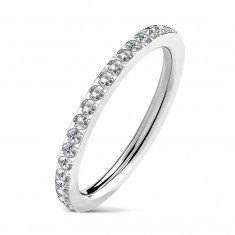 Narrow steel wedding ring with embedded clear zircons, silver color