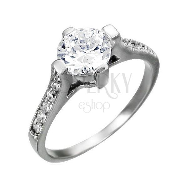 Engagement ring made of surgical steel, big round zircon, zircon lines on shoulders