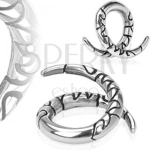 Steel expander with ornaments