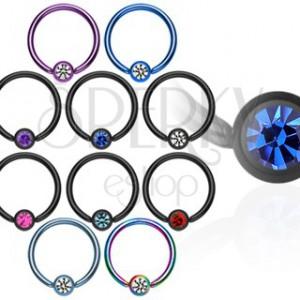 Anodized titanium ball closure ring with zircon